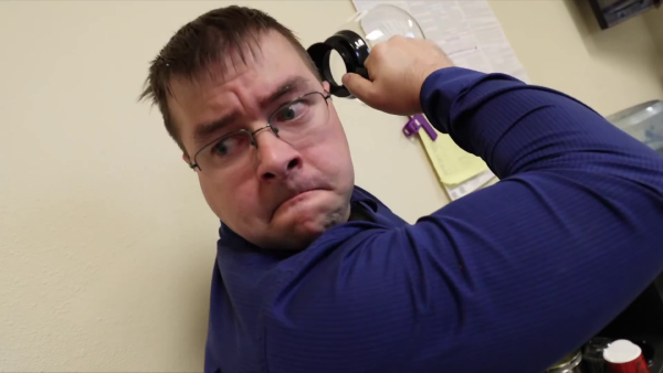 One of the office workers scowls as he readies his coffee pot for mass destruction.