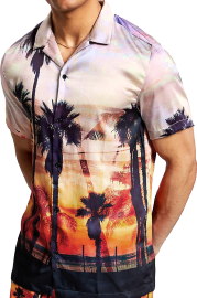 A Cuban collar shirt with an enlarged landscape panorama of a beachside, the black silhouettes of palm trees and a boardwalk in the foreground. The waves are crashing, too… The sky above is light and has an appealing haziness.