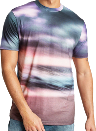 A glowing sunset over the horizon, under thick, heavy clouds, the seas crashing on the sand, all in moody pink and stormy grey-blue ombre. A motion-blur effect makes the pattern look almost tie-dyed.